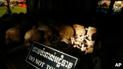"In this photo taken, May 20, 2013, hundreds of former Khmer Rouge victims' bone and skulls are displayed in a memorial at Choeung Ek ""Killing Field"" in Phnom Penh, Cambodia."
