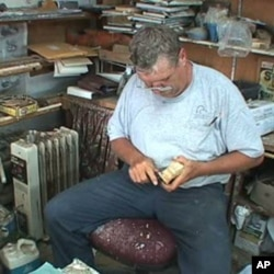 Bob Jobes hard carves a wooden decoy duck.