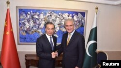 巴基斯坦總理依姆蘭.汗2018年9月8日在伊斯蘭堡會見中國國務委員兼外交部長王毅。