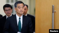 FILE - Hong Kong Chief Executive Leung Chun-ying arrives at a news conference.