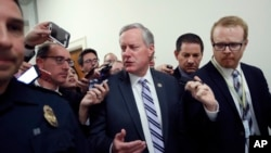 FILE - House Freedom Caucus Chairman Rep. Mark Meadows, R-N.C. speaks with the media on Capitol Hill in Washington, March 23, 2017, following a Freedom Caucus meeting.