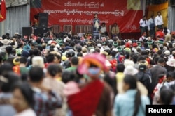 FILE - Myanmar pro-democracy leader Aung San Suu Kyi gives a speech on voter education at the Hopong township in Shan state, Myanmar, Sept. 6, 2015.