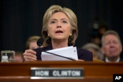FILE - Democratic presidential candidate, former Secretary of State Hillary Rodham Clinton looks toward the dais as she settles into her seat prior to testifying before the House Benghazi Committee, on Capitol Hill in Washington, Oct. 22, 2015.