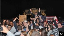 """A crowd of mostly young Americans have gathered in front of the White House after President Obama's announcement of the death of Osama bin Laden. Even at 2:00am on Monday, May 02, 2011, they continue to celebrate the news, shouting """"U-S-A, U-S-A!"""""""