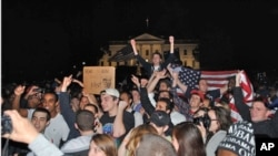 "A crowd of mostly young Americans have gathered in front of the White House after President Obama's announcement of the death of Osama bin Laden. Even at 2:00am on Monday, May 02, 2011, they continue to celebrate the news, shouting ""U-S-A, U-S-A!"""
