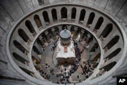 People line to to visit the renovated Edicule in the Church of the Holy Sepulchre, traditionally believed to be the site of the crucifixion of Jesus Christ, in Jerusalem Tuesday, March 21, 2017