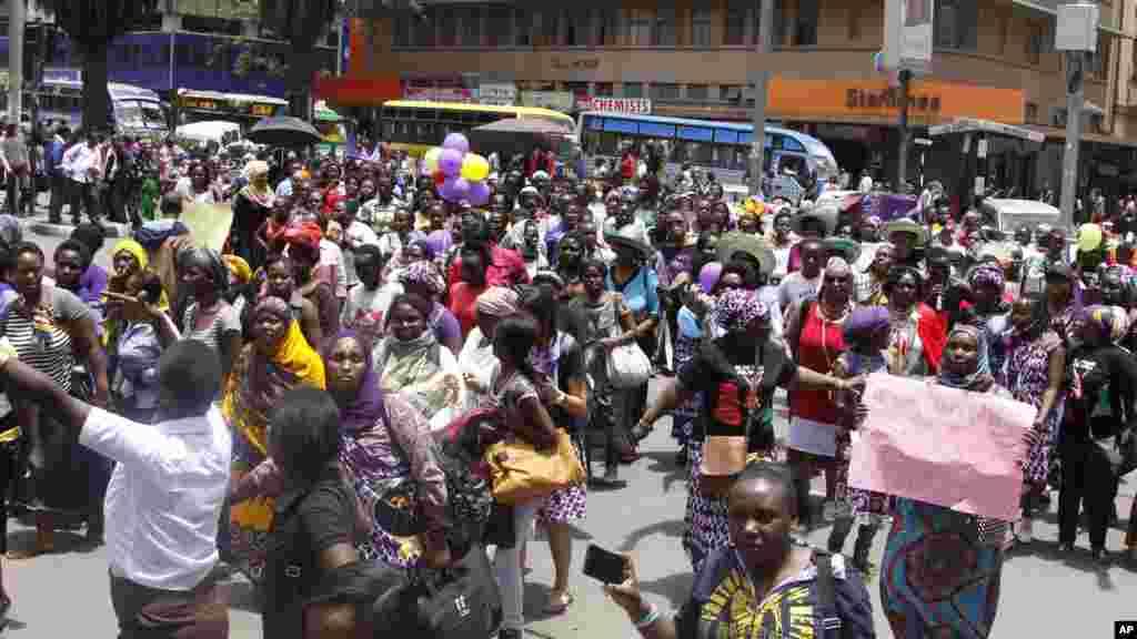 Women from Kenya, Uganda, Tanzania, Rwanda and Burundi participate in the world march of woman in Nairobi, Kenya
