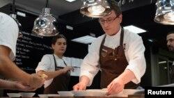 FILE - Basque chef Andoni Aduriz (C) prepares a dish in the kitchen at his restaurant Mugaritz in Renteria, near San Sebastian, Spain, June 3, 2012.