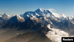 FILE - The Himalayan range of mountains, including Mount Everest (center), the world highest peak.