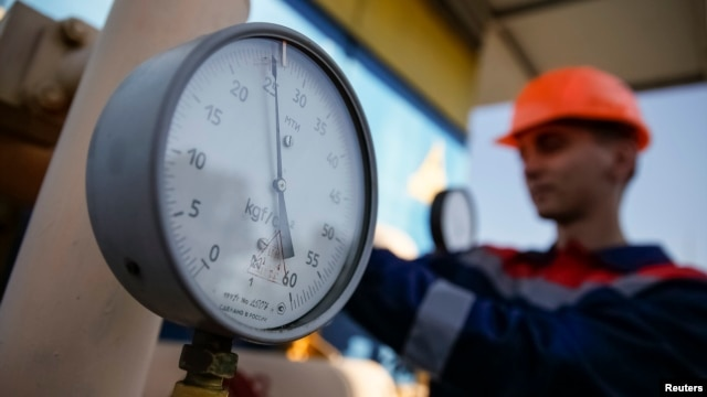 FILE - A pressure gauge is seen at a gas compressor station near Uzhhorod, western Ukraine, May 2014.