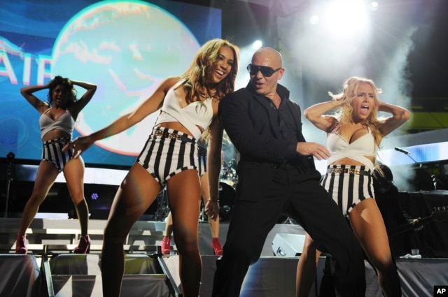 Pitbull performs at the iHeartRadio Ultimate Pool Party at the Fontainebleau Hotel, June 29, 2013 in Miami.