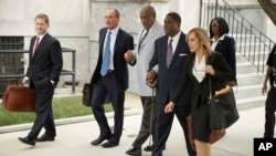 FILE - Bill Cosby, center, departs after a pretrial hearing in his sexual assault case at the Montgomery County Courthouse in Norristown, Pa., Sept. 6, 2016.