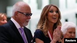FILE - Celine Dion, who with husband Rene Angelil received Order of Canada awards last year, is suspending her singing career to focus on family and health.