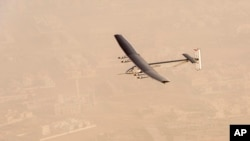 """In this photo released by Solar Impulse, """"Solar Impulse 2"""", a solar-powered airplane flies after taking off from Al Bateen Executive Airport in Abu Dhabi, United Arab Emirates, March 9, 2015."""