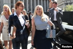 FILE - Virginia Giuffre, an alleged victim of Jeffrey Epstein, leaves after the hearing in the criminal case against Epstein, at Federal Court in New York, Aug. 27, 2019.