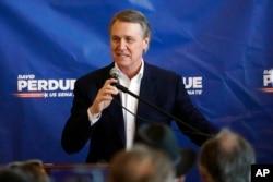 FILE - Republican candidate for Senate Sen. David Perdue speaks at Peachtree Dekalb Airport in Atlanta, Nov. 2, 2020.