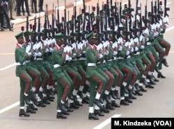 Members of a Nigerian troop guest contingent march in National Day celebrations in Yaounde, Cameroon, May 20, 2018.