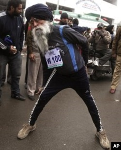Centenarian Fauja Singh stretches himself at a running event in Amritsar, India, Jan. 22, 2012.