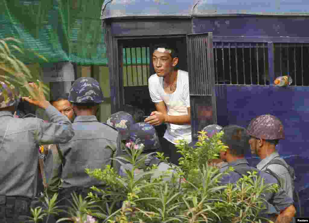 A student protester exits a prison vehicle, as he arrives at a courthouse in Letpadan, March 11, 2015.