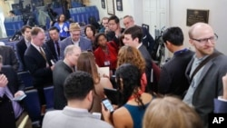 FILE - Reporters gather in the Brady Press Briefing room of the White House, Friday, Feb. 24, 2017.