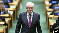 "FILE - Russian Ambassador to the United Nations Vitaly Churkin returns to his seat at United Nations headquarters, Oct. 13, 2016. Russia failed to win re-election to the U.N. Human Rights Council on Friday. ""It was a very close vote,"" Churkin said."