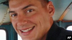 FILE - This undated file photo obtained from the family of Austin Tice shows American freelance journalist Austin Tice, who was