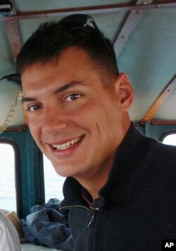 FILE - This undated file photo obtained from the family of Austin Tice, shows American freelance journalist Austin Tice, who was taken hostage in Syria in 2012.