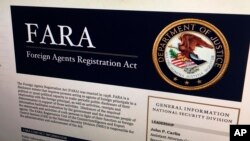 FILE - A portion of the website dealing with the Foreign Agents Registration Act is photographed in Washington, Aug. 18, 2016.