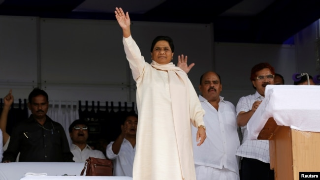 FILE - The Bahujan Samaj Party (BSP) chief Mayawati waves to her supporters during an election campaign rally on the occasion of the death anniversary of Kanshi Ram, founder of BSP, in Lucknow, India, Oct. 9, 2016.