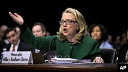 FILE - Hillary Clinton, then the U.S. secretary of state, testifies on Capitol Hill in Washington, January 23, 2013, before the Senate Foreign Relations Committee hearing on the deadly September attack on the U.S. diplomatic mission in Benghazi, Libya.