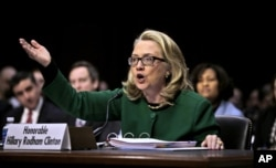 FILE - Then-Secretary of State Hillary Clinton testifies on Capitol Hill in Washington before the Senate Foreign Relations Committee hearing on the attack on the U.S. diplomatic mission in Benghazi, Libya, Jan. 23, 2013.