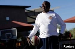 "FILE - Former Harlem Globetrotter and Basketball Hall of Famer Meadow ""Meadowlark"" Lemon poses for a portrait in Scottsdale, Arizona, Dec. 7, 2010."