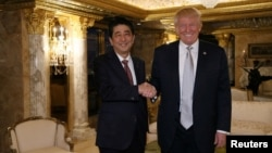 Japan's Prime Minister Shinzo Abe meets with U.S. President-elect Donald Trump (R) at Trump Tower in Manhattan, New York, U.S., November 17, 2016. Cabinet Public Relations Office/HANDOUT via Reuters