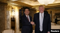 Japan's Prime Minister Shinzo Abe meets with U.S. President-elect Donald Trump at Trump Tower in New York, on November 17, 2016. Cabinet Public Relations Office/HANDOUT via Reuters