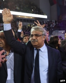 Co-chair of the pro-Kurdish Peoples' Democratic Party Mithat Sancar waves as he attends the 4th Ordinary Peoples' Democratic Party congress in Ankara on Feb. 23, 2020.
