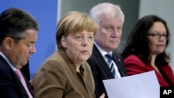 From left, Sigmar Gabriel, Chairman of the German Social Democrats, German Chancellor Angela Merkel, Horst Seehofer, Chairman of the German Christian Social Union and German Labor Minister Andrea Nahles address the media during a press conference in Berlin, Germany, Thursday, April 14, 2016, on the results of a meeting of the heads of the German government coalition.