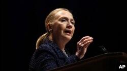 Secretary of State Hillary Rodham Clinton gestures as she gives a speech Thursday, Dec. 6, 2012, at Dublin City University in Dublin, Ireland.