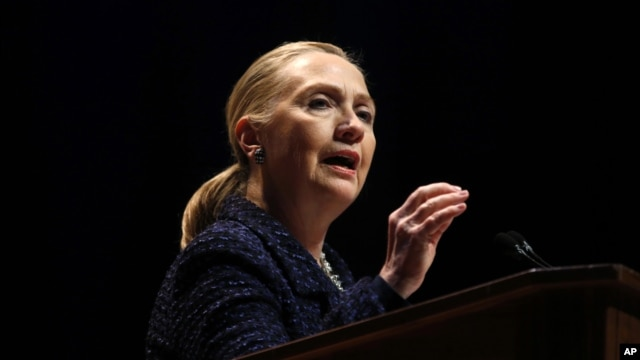 Secretary of State Hillary Rodham Clinton gestures as she gives a speech at Dublin City University in Dublin, Ireland, December 6, 2012.