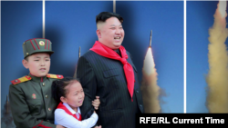 North Korea leader with rockets and kids