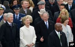 Former President George W. Bush, right, his wife Laura, Former Secretary of State Hillary Clinton and Former President Bill Clinton wait for the 58th Presidential Inauguration for President-elect Donald Trump at the U.S. Capitol in Washington, Jan. 20, 20
