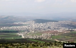 A general view shows the Kurdish city of Afrin, in Aleppo's countryside, March 18, 2015.