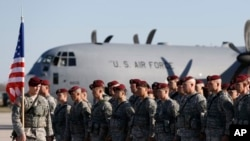 FILE - Members of the U.S. Army 173rd Airborne Brigade attend a welcome ceremony upon their arrival at a Lithuanian air force base in Siauliai, Lithuania, April 26, 2014. Troops from the brigade will be among those participating in exercises Rapid Trident.