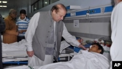 Pakistan's Prime Minister Nawaz Sharif meets with some of the victims of Sunday's suicide bombing. Sharif has promised to intensify efforts against terrorism after the attack.