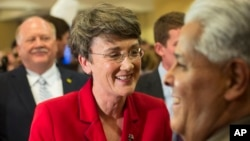 FILE - Heather Wilson visits with supporters, Nov. 6, 2012, at a Republican election party in Albuquerque, New Mexico.