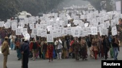 Women hold placards as they march during a rally organized by Delhi Chief Minister Sheila Dikshit (unseen) protesting for justice and security for women, in New Delhi, January 2, 2013.
