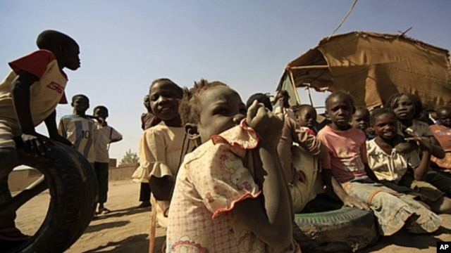 South Sudanese children wait outside their tent at Andalus camp during a visit by UN High Commissioner for Refugees Antonio Guterres in Khartoum, Sudan, January 11, 2012.