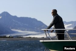 FILE - U.S. President Barack Obama views Bear Glacier on a boat tour of Kenai Fjords National Park in Seward, Alaska, Sept. 1, 2015. Reining in global warming is key, said speakers Thursday at the World Climate Summit in Washington.