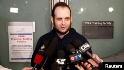 Joshua Boyle speaks to reporters after arriving with his wife and three children at Toronto Pearson International Airport, nearly five years after he and his wife were abducted in Afghanistan in 2012 by the Taliban-allied Haqqani network, in Toronto, Ontario, Oct. 13, 2017.