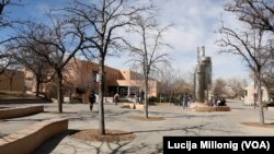 Students walk across the University of New Mexico campus in Albuquerque, New Mexico.