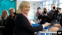 French far-right leader and National Front Party, Marine Le Pen, prepares to vote for the first round of local elections, March 22, 2015, in Henin-Beaumont, northern France.